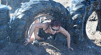 Hundreds get dirty at annual Chino Mud Run photo