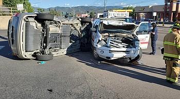 Van t-boned by emergency vehicle, rolls photo