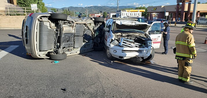 A van rests on its side after being t-boned by a Life Line Ambulance Services vehicle in Prescott Friday, Aug. 16, 2019. (Prescott Police Department/Courtesy)