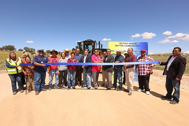 Members of the Beshbito community gather for a ribbon-cutting ceremony celebrating the completion of a three-mile road resurfacing project for Navajo Route 9056. (Photo/Navajo Department of Transportation)