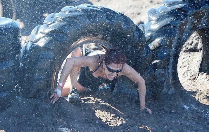 Over 300 people competed in the fourth annual Chino Valley Mud Run at Old Home Manor in Chino Valley Saturday, Aug. 17, 2019. The 5 kilometer race had 22 obstacles that tested each racers endurance and fitness. (Les Stukenberg/Review)