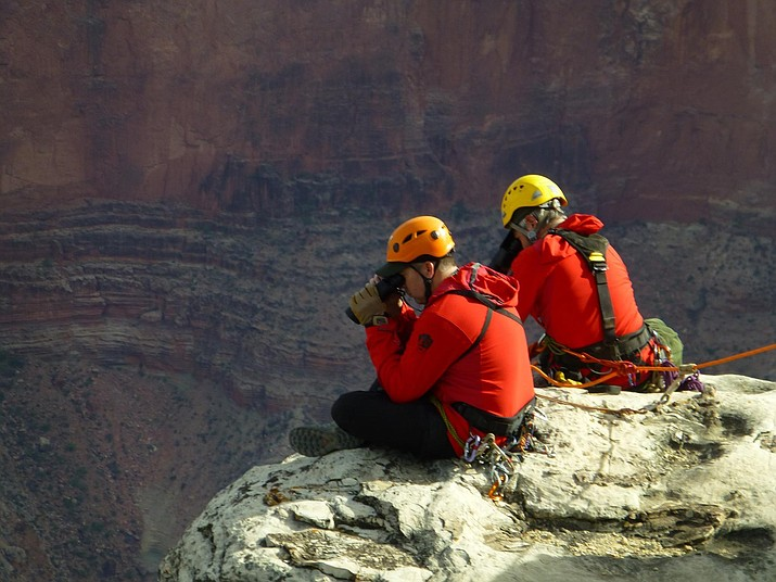 Part of a Grand Canyon Emergency Services Search and Rescue crew uses binoculars to search difficult terrain. (Photo/Grand Canyon Emergency Services)