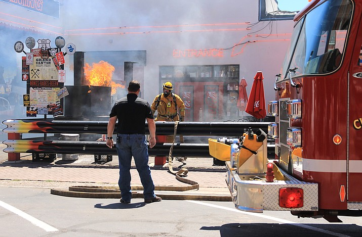Volunteer firefighters John Moede and Jeff Dent were the first on scene for a grill fire at Cruiser's restaurant Aug. 19. (Wendy Howell/WGCN)