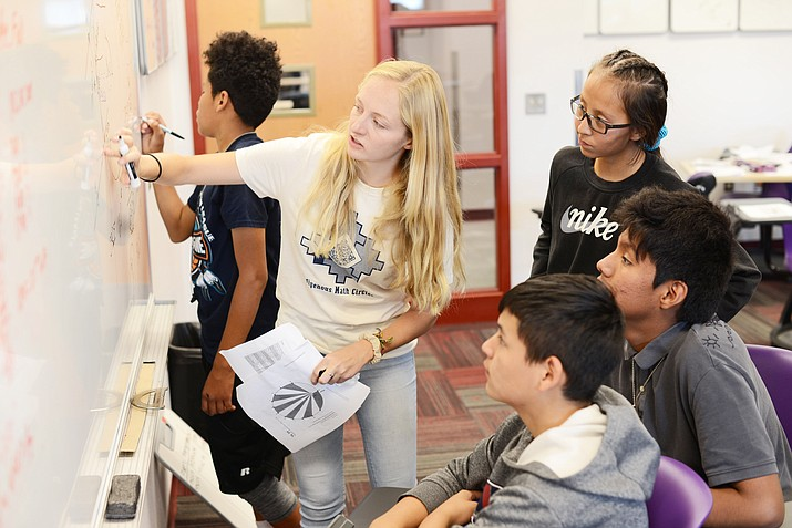 An instructor for the Math Circles Summer Camp at Navajo Technical University demonstrates how to use formulas to solve a problem. During the two week camp, students learned the importance of the Navajo Culture through mathematics. (Photos/Navajo Technical Univeristy)