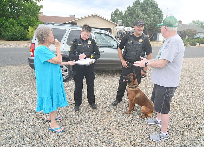 "Prescott Valley Police Sgt. Nancy Roberts and officer Paul Hine with K-9 ""Groot"" attend the annual Neighborhood Block Watch party in conjunction with National Night Out in the 7200 block of Manley Drive in Prescott Valley Tuesday, Aug. 6, 2019. To learn more about Block Watch programs, call the Police Department at 928-772-9261. (Les Stukenberg/Prescott News Network)"