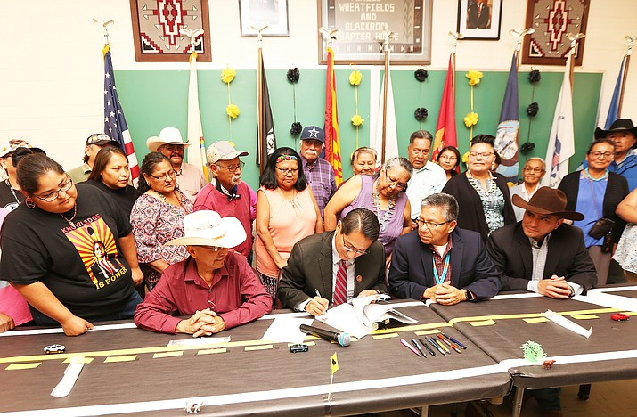 Navajo Nation President Jonathan Nez signs a contract witht eh Navajo Engineering and Construction Authority Aug. 11 to begin Phase 1 of an expansion of Navajo Road 12. (Photo/Navajo Department of Transportation)