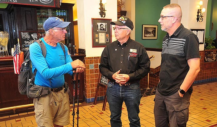 Cross-country walker and veteran William Shuttleworth, left, talks with fellow veterans Phil Goode and Jeff Timm at the Hassyampa Inn Monday, Aug. 19, 2019, in downtown Prescott. (Les Stukenberg/Courier)