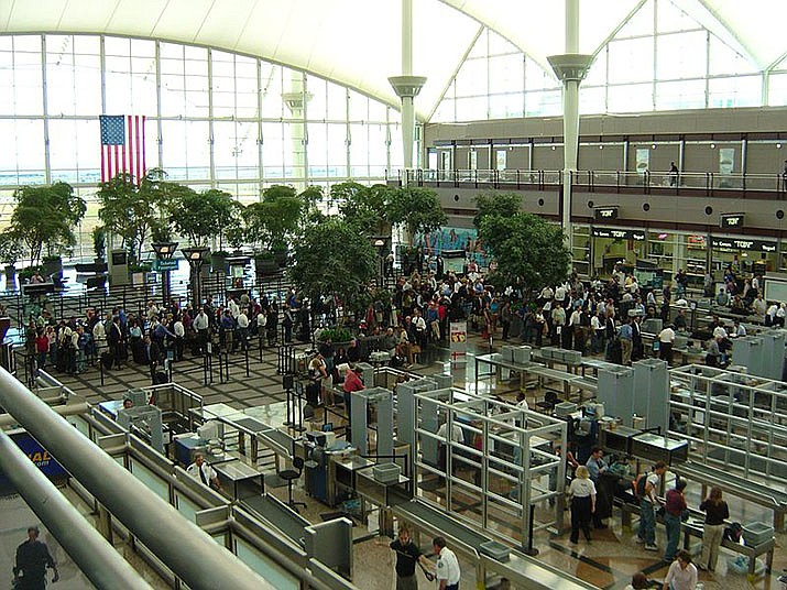 Airport security lines are shown at Denver International Airport.  Arizona Department of Transportation officials are reminding travelers that they offer federally compliant Travel IDs at all state Motor Vehicle Division locations. (Photo by Kitt Hodsden/Public Domain)