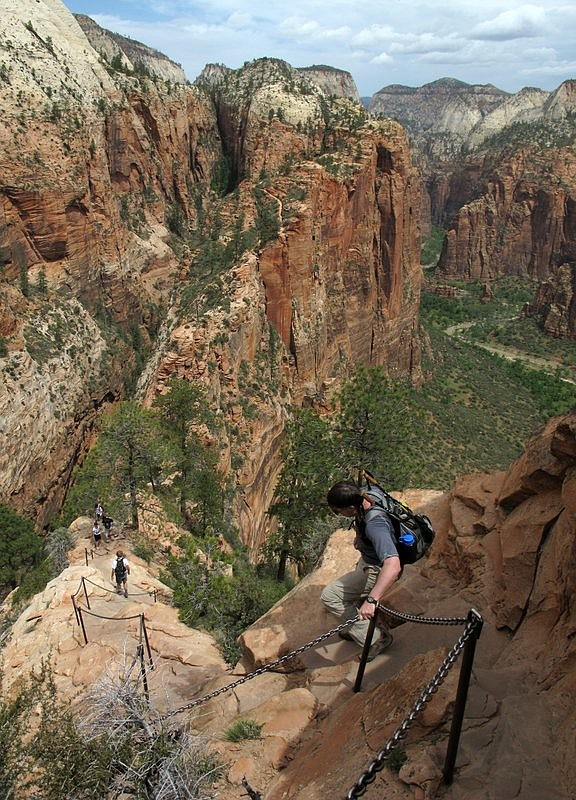 Hikers climb down the Angels Landing trail in Zion National Park, in Utah. National Park Service officials say the popular Angels Landing trail at Zion National Park in southern Utah will be temporarily closed for repairs beginning Tuesday, Aug. 20, 2019. (Jud Burkett/The Spectrum via AP, File)