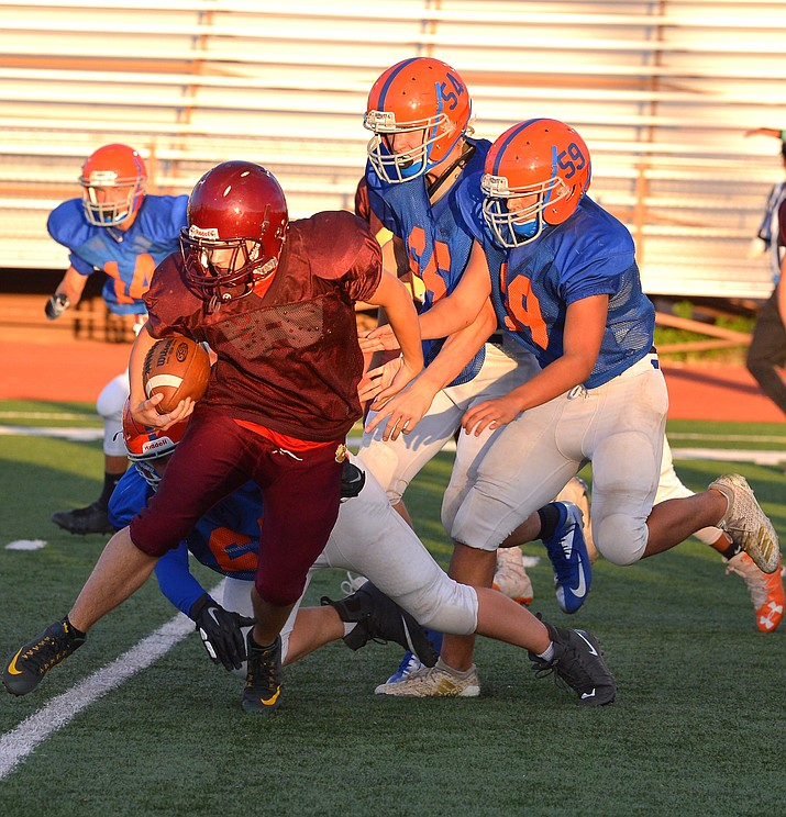 The Winslow Bulldogs scrimmaged the Chino Valley Cougars Aug. 15 in Winslow. (Todd Roth/NHO)