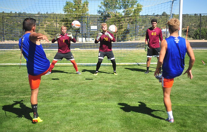 Embry-Riddle soccer goalies Michael Serdynski, Alastair Stark and Lucas Marin take shots during practice Tuesday, August 20, 2019, in Prescott.  (Les Stukenberg/Courier)
