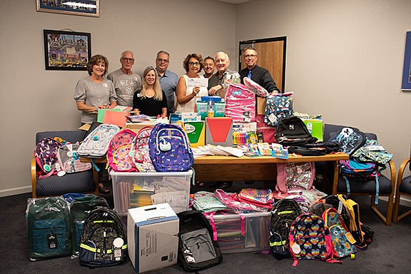 """Kingman Academy of Learning received school supplies donations from Mission Bank's """"Our Town Cares!"""" supply drive Monday, Aug. 19, 2019. (From left to right) Kari Hill, George and Debbie Catt, Jeff Kulenovic, Susan Chan, Carl Brooks, Darrell Lautaret and Eric Lillis. (Photo by Vanessa Espinoza/Daily Miner)"""