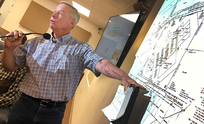 Dugan McDonald of High View LLC explains his request for a zoning map change from R1L-35 residential single-family to C2-1 commercial general sales so he can build a shopping center in Rimrock. The center would be located at the southeast corner of E. Beaver Creek and N. Dave Wingfield roads. VVN/Bill Helm