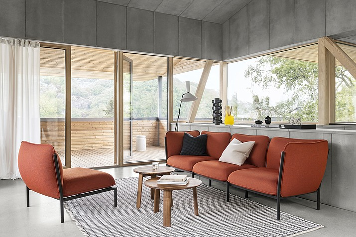 This photo shows Hem's Kumo modular sofa. On the furniture front in the terracotta palette, we're seeing trim, tailored pieces that are unquestionably modern. Hem's Kumo from Norwegian design team Anderssen & Voll is offered in a vibrant, fiery rust hued wool they call Canyon. (Erik Lefvander/Hem via AP)
