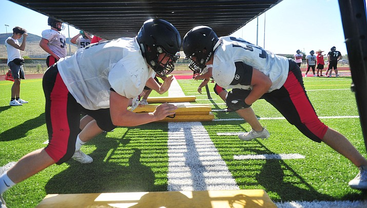 Bradshaw Mountain's linemen work on a drill during practice at the high school, Wednesday, August 14, 2019. (Les Stukenberg/Courier, File)