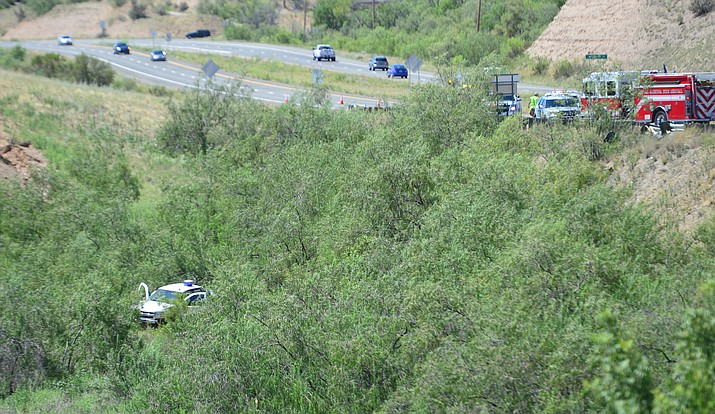 A white truck careened off Highway 69 into thick brush near Main St. in Dewey Thursday morning, Aug. 22. (Les Stukenberg/Courier)
