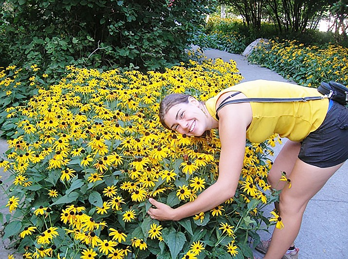 Love of gardening and flowers — this woman is hugging Black-Eyed Susans (Rudbeckia) (Watters Garden Center/Courtesy)