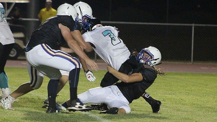 Powers Corbin, right, and the Bulldogs hope to open the season with another victory Friday night after dismantling Pinon last season 58-14. (Daily Miner file photo)