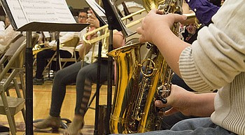 Kingman Middle School band booster hosts fundraiser for new instruments, sheet music photo