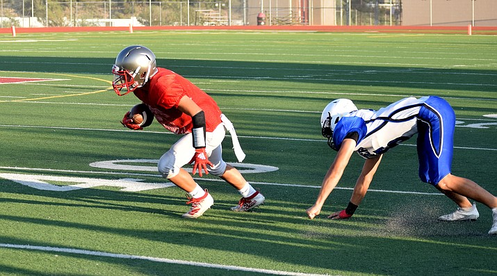 Mingus junior Jonny Sanchez runs past a Paradise Honors defender during their scrimmage last week. VVN/James Kelley