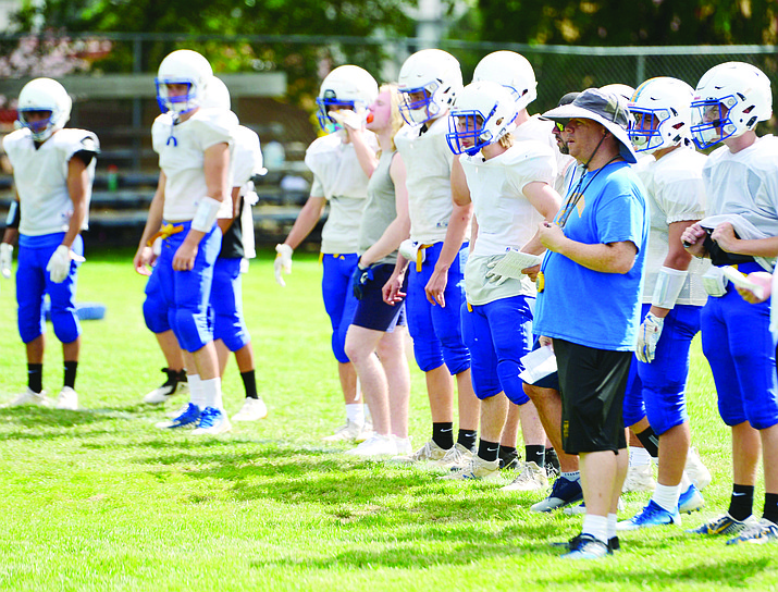 Prescott Head Coach Cody Collett watches the drill during practice at the high school, Wednesday, August 14, 2019. (Les Stukenberg/Courier, File)
