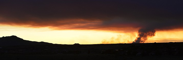 The Sheridan Fire, seen in the distance from Prescott at sunset Wednesday, Aug. 21, 2019, is burning 23 miles from Prescott and has doubled in size to more than 8,500 acres. (Les Stukenberg/Courier)