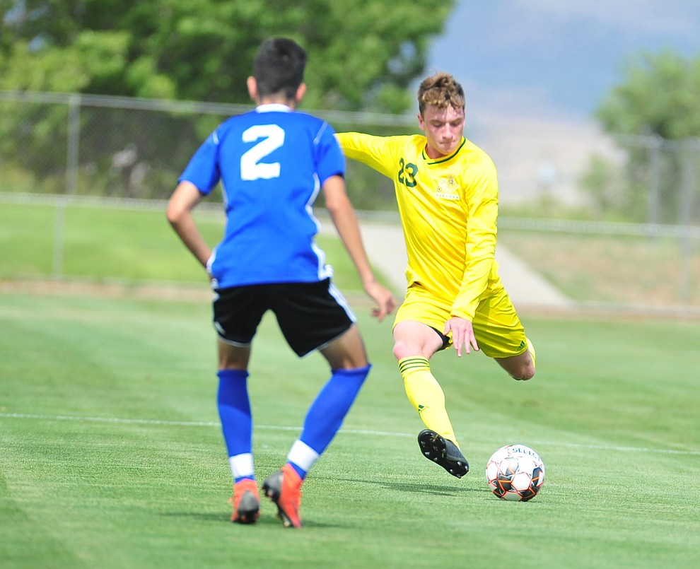 Yavapai's Loic Baures makes a long pass as the Roughriders host South Mountain Community College Thursday, August 22, 2019, in Prescott Valley. (Les Stukenberg/Courier)