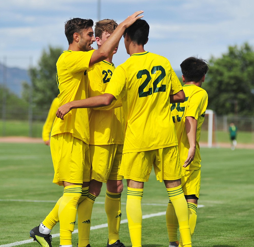 Yavapai's Manuel Quiroz (22) gets congratulated on the first goal as the Roughriders host South Mountain Community College Thursday, August 22, 2019, in Prescott Valley. (Les Stukenberg/Courier)