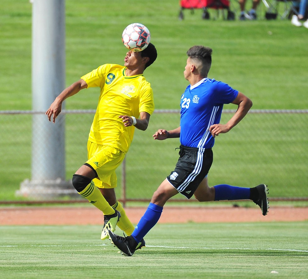 Yavapai's Jesus Medina heads the ball forward as the Roughriders host South Mountain Community College Thursday, August 22, 2019, in Prescott Valley. (Les Stukenberg/Courier)