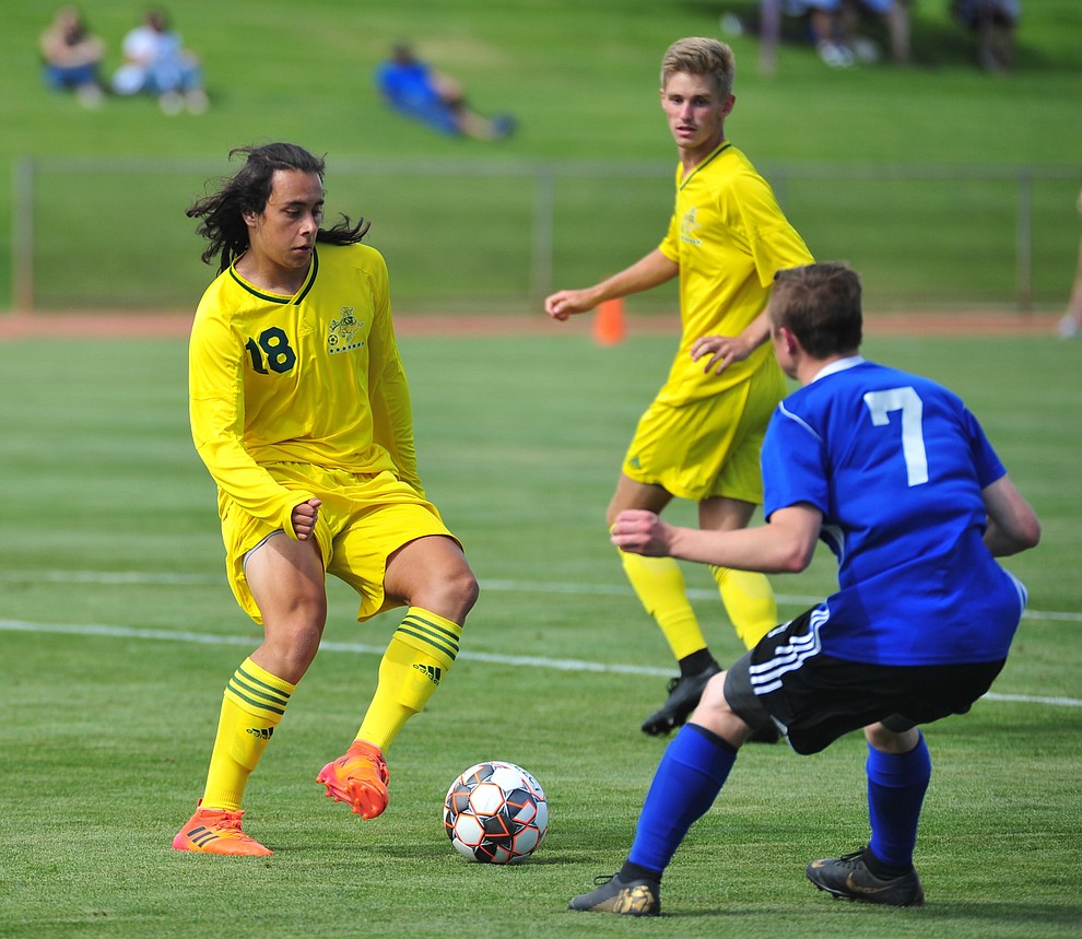 Yavapai's Kristian Quiros maneuvers the ball in the box just before he scores the third goal as the Roughriders host South Mountain Community College Thursday, August 22, 2019, in Prescott Valley. (Les Stukenberg/Courier)