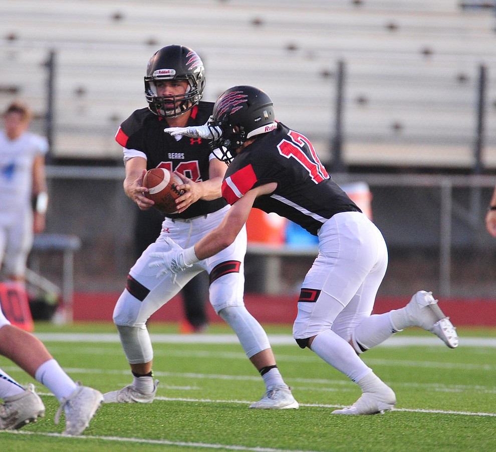 Bradshaw Mountain's Jos h Grant hands off to Titus King as the Bears host Estrella Foothills in their 2019 football home opener Friday, Aug. 23, 2019, in Prescott Valley. (Les Stukenberg/Courier)
