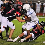 Bradshaw Mountain's Roberto Gonzalez and Eladio Rodriguez make a tackle as the Bears host Estrella Foothills in their 2019 football home opener Friday, Aug. 23, 2019, in Prescott Valley. (Les Stukenberg/Courier)