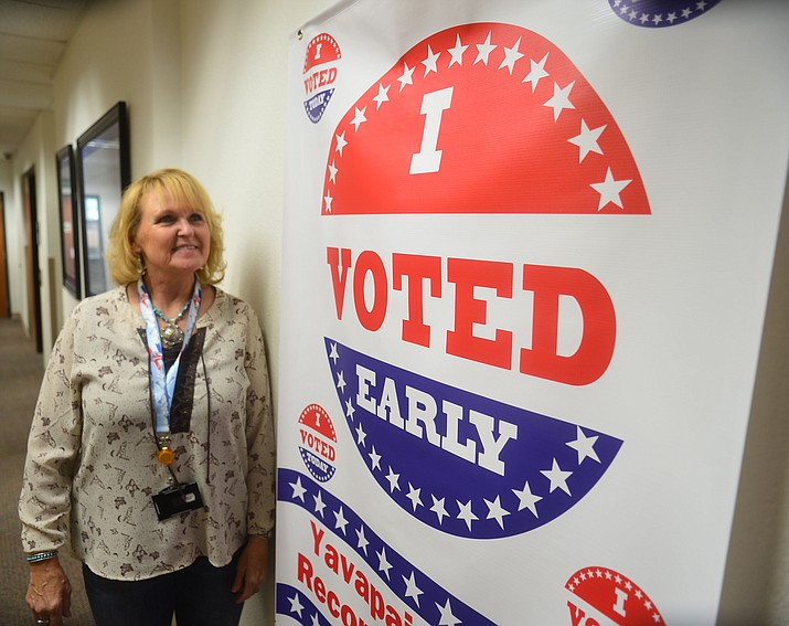 "Yavapai County Recorder Leslie Hoffman stands in front of an ""I Voted Early"" sign at the Yavapai County Recorder's Office in 2019 at the Yavapai County Administration Building. (Les Stukenberg/Courier, file)"