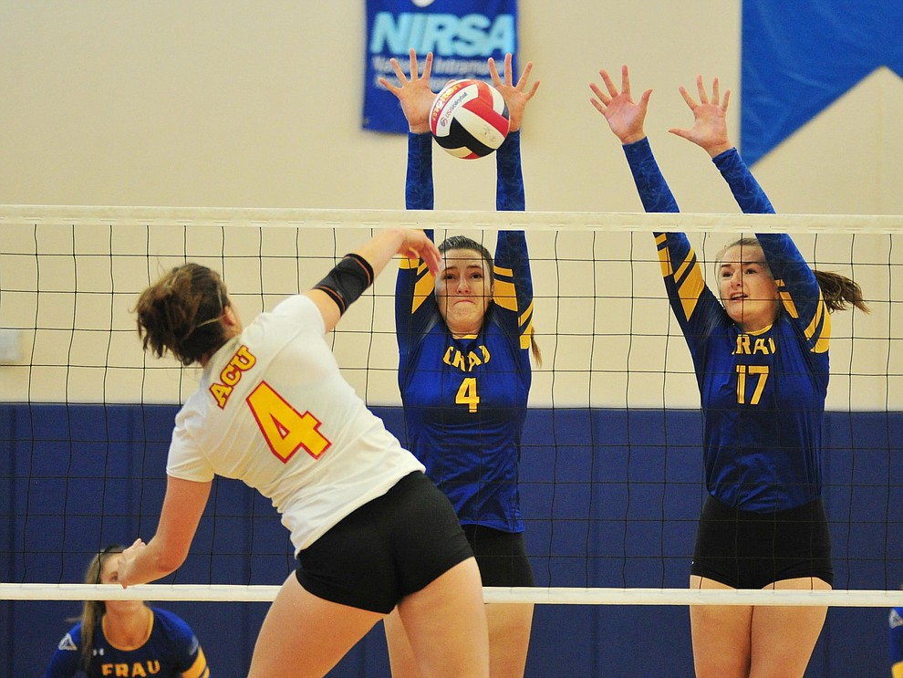 Embry Riddle's Elisa Pauzer and Julia Kjenstad get a block as the Eagles take on Arizona Christian Saturday, Aug. 24, 2019, in Prescott.  (Les Stukenberg/Courier)