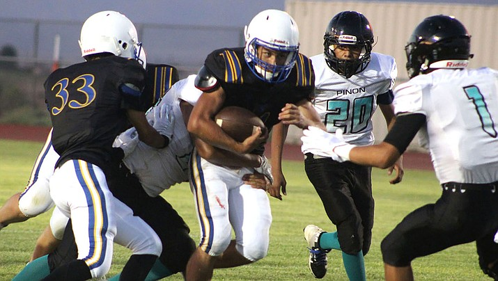 Austin Dias rushed for three touchdowns Friday night as Kingman High picked up a 58-0 victory over Pinon. Four different Bulldogs rushed for at least one score in the one-sided affair. (Daily Miner file photo)