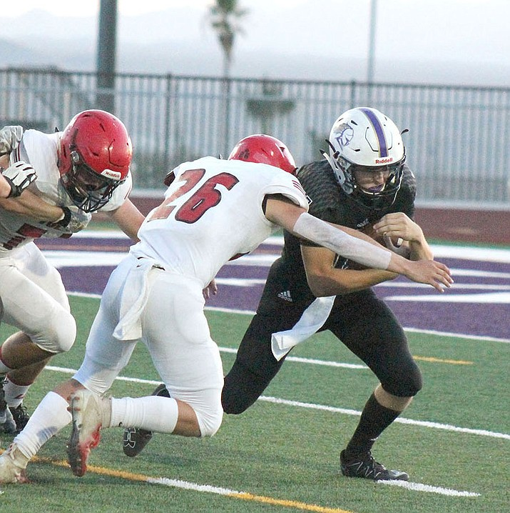 Lee Williams' Wesley Boyd sacks Lake Havasu quarterback Cole Fuller during a 6-0 win over the Knights on Friday night. (Photo courtesy of Peter Castillo/ Today's News-Herald)