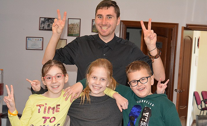 Matt Newell in his suburban Moscow classroom this year with three students – Alisa, Polina and Gleb. (Matt Newell/Courtesy)