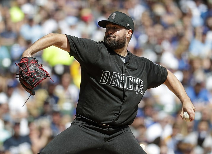 Arizona Diamondbacks starter Robbie Ray throws during the first inning of a baseball game against the Milwaukee Brewers Sunday, Aug. 25, 2019, in Milwaukee. (Morry Gash/AP)