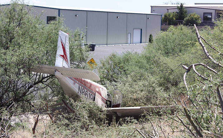 A small plane was pushed off a runway at Cottonwood Airport on Sunday morning by a sudden gust of wind. The two occupants weren't injured. Courtesy of Cottonwood Police
