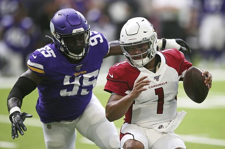 Arizona Cardinals quarterback Kyler Murray (1) runs from Minnesota Vikings defensive end Ifeadi Odenigbo (95) during the first half of a preseason game, Saturday, Aug. 24, 2019, in Minneapolis. (Jim Mone/AP)