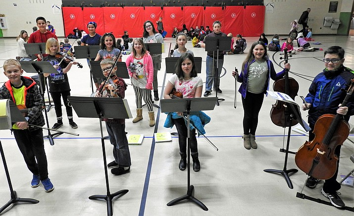 Granville students with repainted music stands. (HUSD/Courtesy)