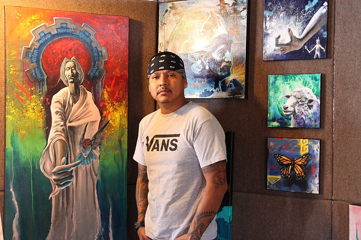 Navajo artist Nate Begay tells traditional Navajo stories infused with bold colors and a modern graffiti style. (Erin Ford/WGCN)