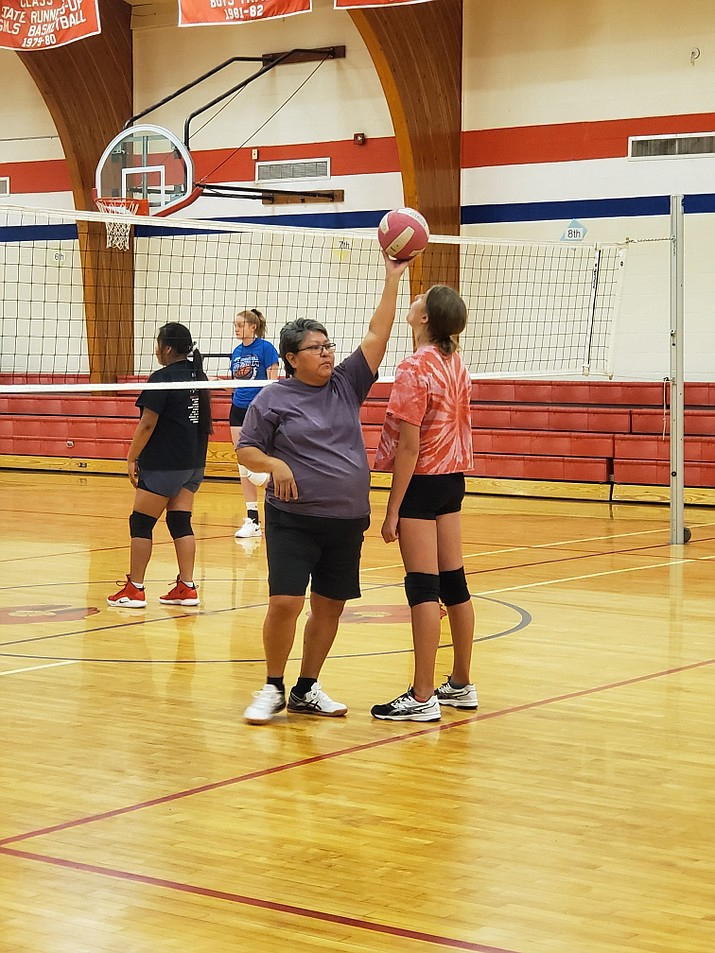 Assistant volleyball coach Leona Begishie works with the team on positioning and calling balls during practice Aug. 22. (Erin Ford/WGCN)