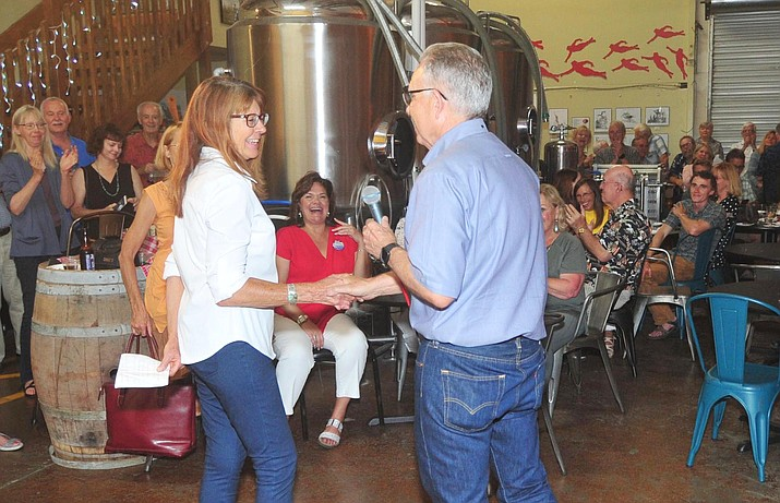 City Councilman Phil Goode, right, congratulates Cathey Rusing on her victory Tuesday, Aug. 27, 2019, at Thumb Butte Distillery as the City of Prescott held a primary election for three council seats and the mayor. Rusing was the top vote-getter in the election. (Les Stukenberg/Courier)