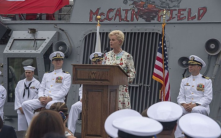 Cindy McCain spoke at the 25th anniversary of the U.S.S. John S. McCain's commissioning. Many efforts to honor McCain, who died a year ago from brain cancer, are moving forward. (Photo by Petty Officer Second Class William McCann/U.S. Navy)