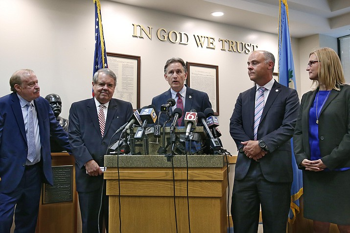 Oklahoma Attorney General Mike Hunter, center, answers a question during a news conference following the announcement of the Opioid Lawsuit decision in Norman, Okla., Monday. Pictured from left are attorneys Reggie Whitten, Michael Burrage, Hunter, attorney Brad Beckworth and Terri White, Commissioner, Oklahoma Department of Mental Health and Substance Abuse Services. (Sue Ogrocki/AP)