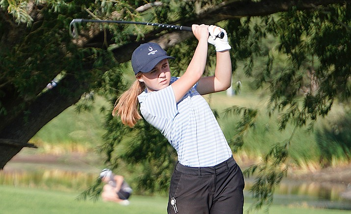 Prescott girls golf's Brannagh Woods tees off on the eight hole at Antelope Hills Golf Course during the team's match against Lee Williams on Tuesday, Aug. 27, 2019. (Aaron Valdez/Courier)