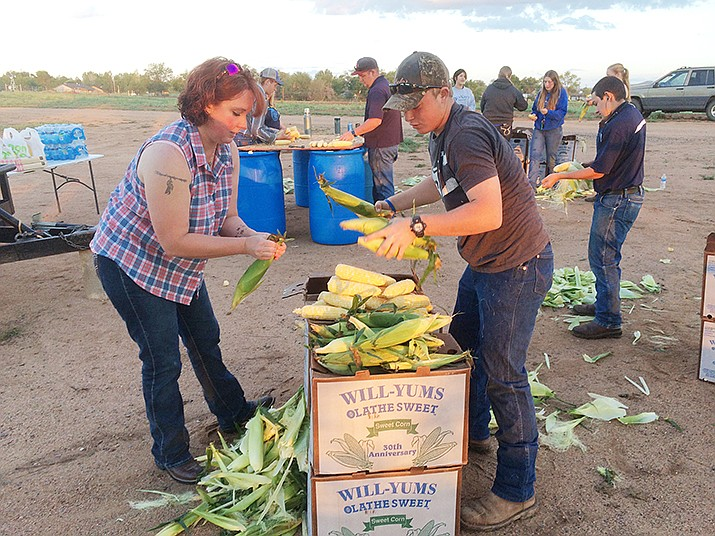 Karen Self and Levi Self shuck corn to prepare them for the Saturday, Sept. 3, 2016 Corn Dinner. The annual event is a fundraiser for the Future Farmers of America chapter at Chino Valley High School. (Review file photo)