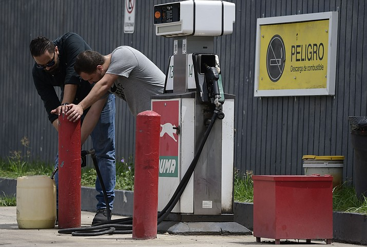 Citizens stock up on gasoline a few hours before the passing of tropical storm Dorian, in Canovanas, Puerto Rico, Wednesday, Aug. 28, 2019. Puerto Rico is facing its first major test of emergency preparedness since the 2017 devastation of Hurricane Maria as Tropical Storm Dorian nears the U.S. territory at near-hurricane force. (AP Photo/Carlos Giusti)