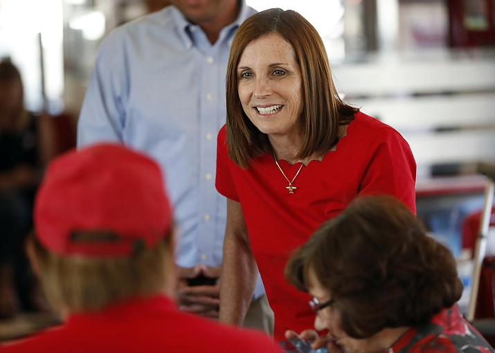 "In this Nov. 6, 2018 file photo, then-Arizona Republican senatorial candidate Martha McSally speaks with voters at Chase's diner in Chandler, Ariz. A Phoenix-area businessman says he will challenge McSally in next year's Republican primary. Daniel McCarthy told The Associated Press on Wednesday, Aug. 28, 2019 that Congress needs ""conservative outsiders to step in and push back quickly."" His challenge could pose a serious threat to McSally, who was appointed to finish John McCain's Senate term. (AP Photo/Matt York, File)"